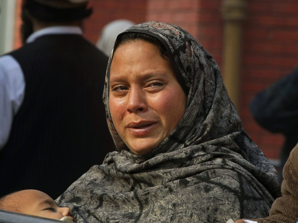 PHOTO: A Pakistani woman weeps as she waits at a hospital, where victims of a Taliban attack are being treated in Peshawar, Pakistan, Dec. 16, 2014.