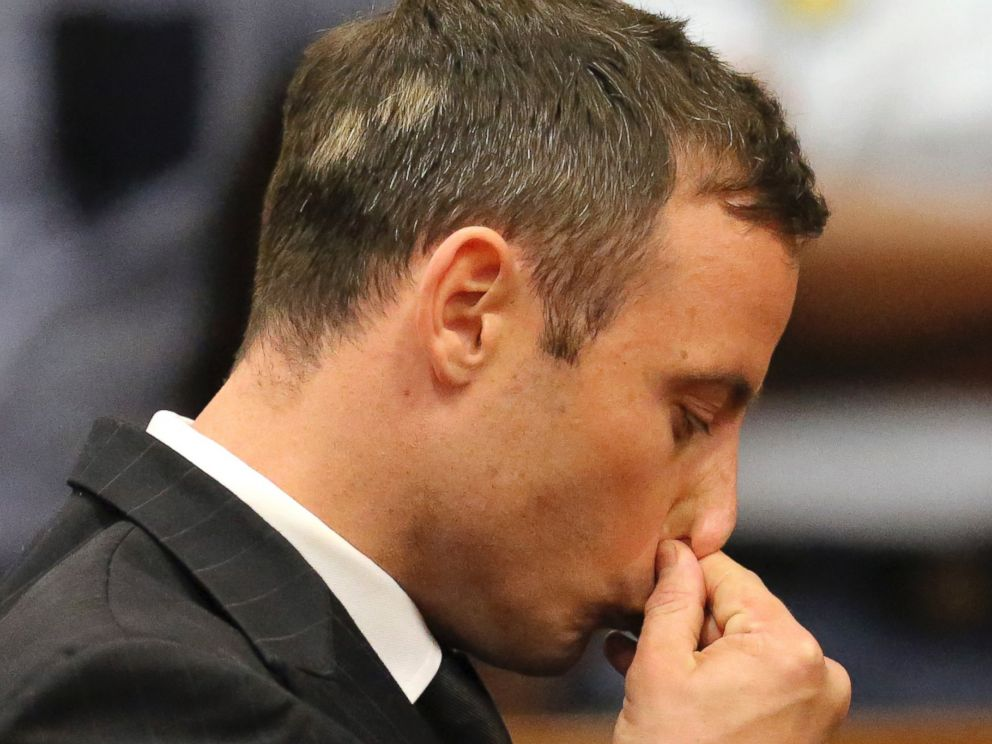 PHOTO: Oscar Pistorius, center, gestures after he was sentenced in court in Pretoria, South Africa, Oct. 21, 2014.