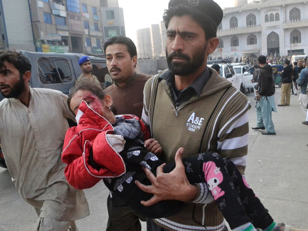 PHOTO: A Pakistani girl, who was injured in a Taliban attack in a school, is rushed to a hospital