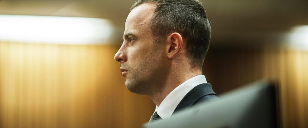 PHOTO: Oscar Pistorius stands in the dock in court in Pretoria, South Africa, May 14, 2014, as the judge overseeing his murder trial ordered him to undergo psychiatric tests.