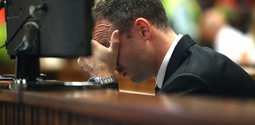 PHOTO: Oscar Pistorius places his hand over his face while sitting in the dock in court on the third day of his trial at the high court in Pretoria, South Africa, Wednesday, March 5, 2014.