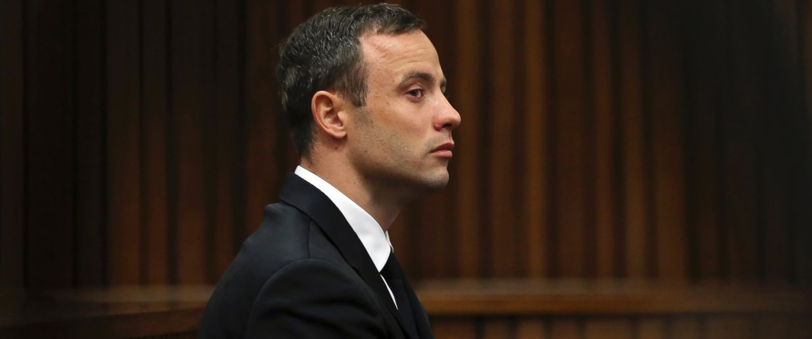 PHOTO: Oscar Pistorius sits in the dock at a court in Pretoria, South Africa, April 7, 2014.