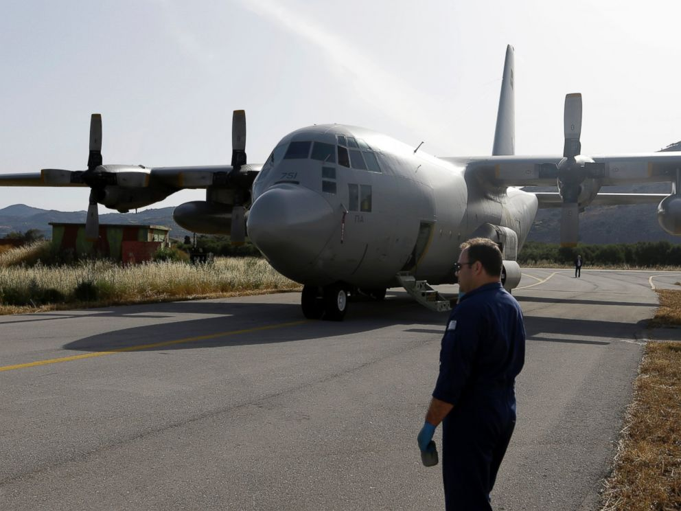 PHOTO: An engineer stands in front of a C-130 HAUP of the Hellenic Air Force, which took part in the searching operation of the missing Egypt plane, at the military air base of Kastelli on the southern Greek island of Crete, May 20, 2016.