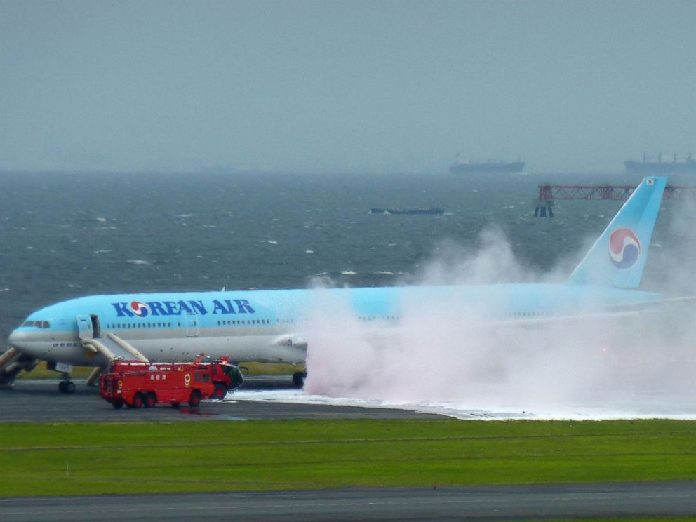 PHOTO: White smoke rises from an engine of a Korean Air jet as firefighters battle an apparent engine fire on the tarmac at Haneda Airport in Tokyo May 27, 2016. All the passengers and crew were evacuated unharmed, Japanese media reported.