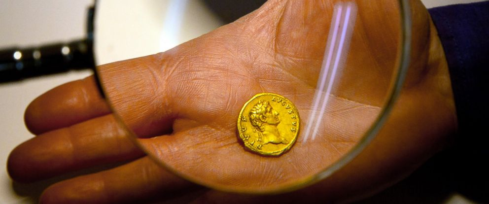 PHOTO: Israeli Antiquities Authority official Donald T. Ariel holds a rare, nearly 2,000-year-old gold coin, at the Antiquities Authority office inside the Israel Museum in Jerusalem on March 14, 2016.