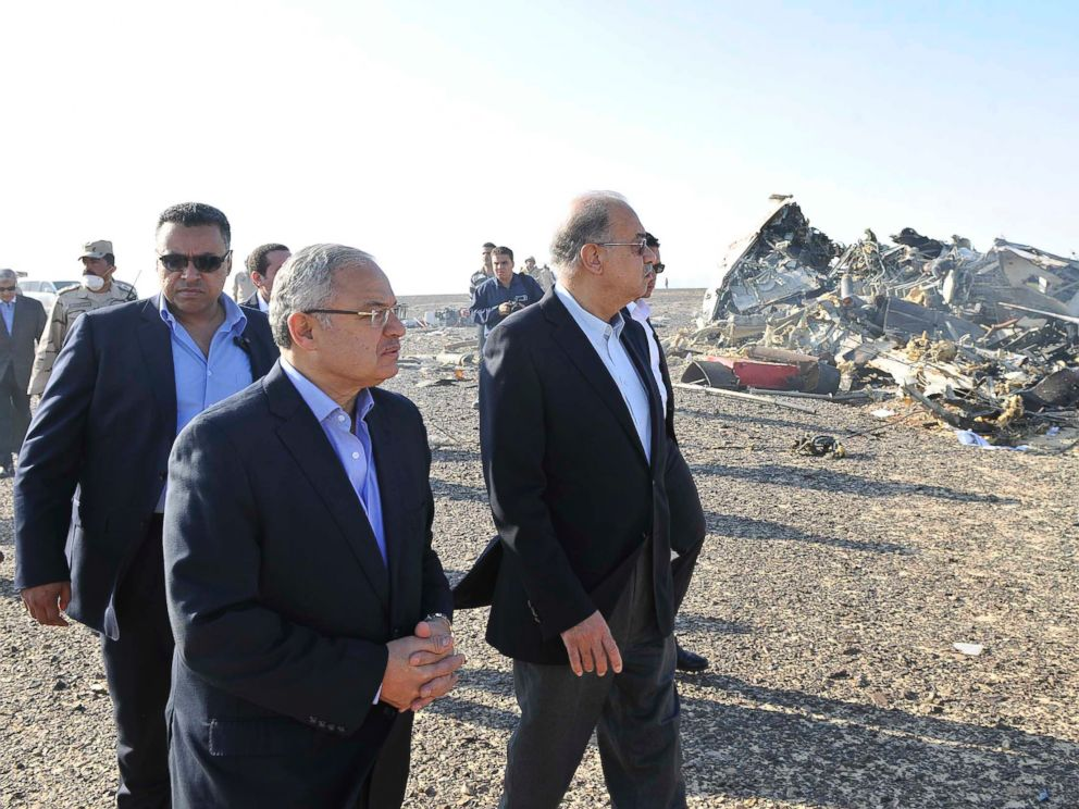 PHOTO: In this photo released by the Prime Ministers office, Sherif Ismail, center, visits the site where a plane crashed in Hassana, Egypt on Saturday, Oct. 31, 2015.