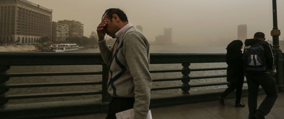 PHOTO: People walk on a bridge during a sandstorm in Cairo, Egypt, Feb. 10, 2015.