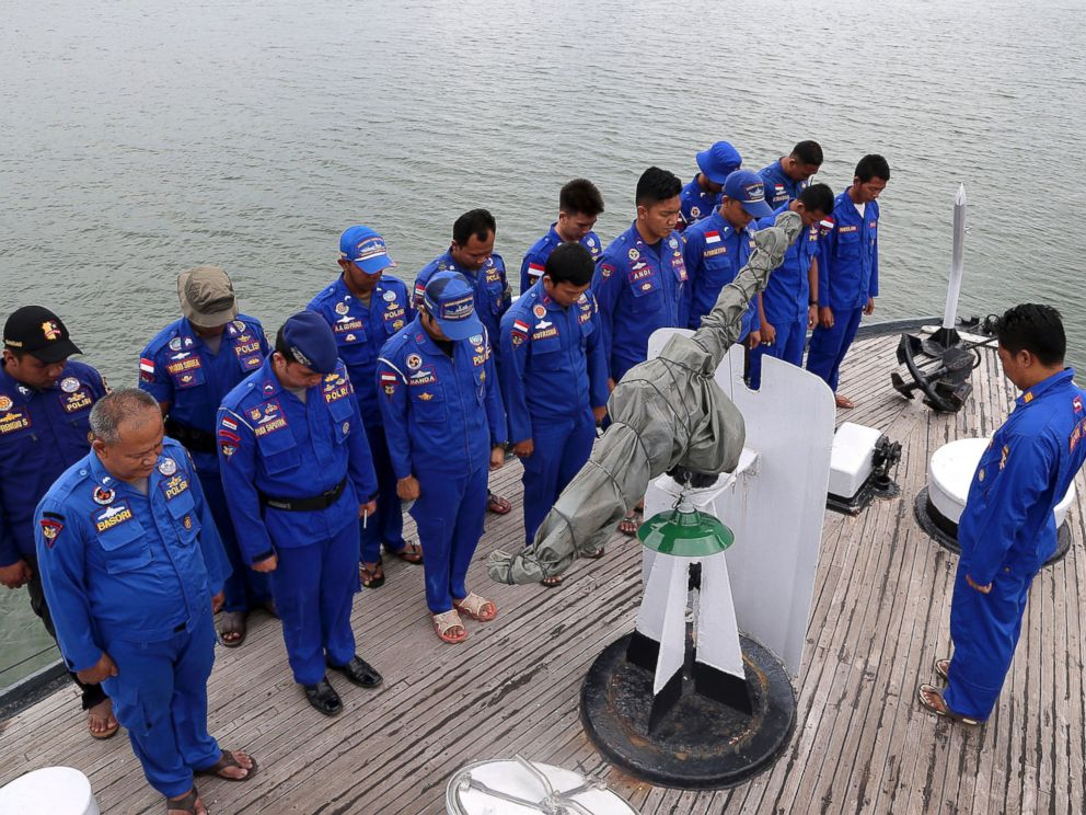 PHOTO: Members of Indonesias Marine Police pray on board a search and rescue ship before a search operation for the missing AirAsia flight 8501, at Pangkal Pinang port in Sumatra Island, Dec. 29, 2014 in Indonesia.