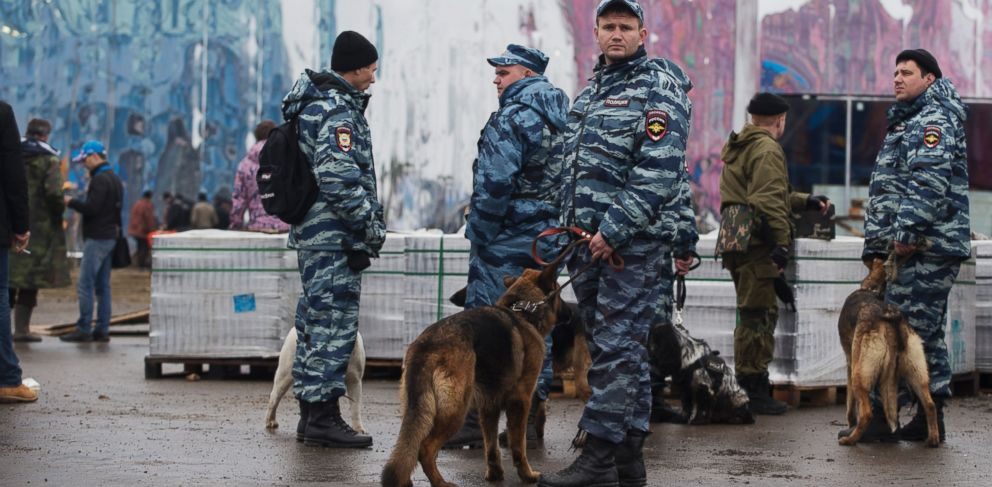 PHOTO: Russian police patrol with their dogs inside the Olympic Park as preparations continue for the 2014 Winter Olympics, Jan. 29, 2014, in Sochi.