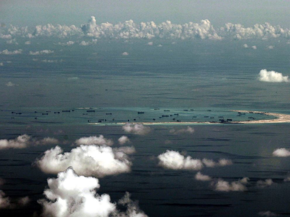 PHOTO: In this May 11, 2015, file photo, this aerial photo taken through a glass window of a military plane shows Chinas alleged on-going reclamation of Mischief Reef in the Spratly Islands in the South China Sea.