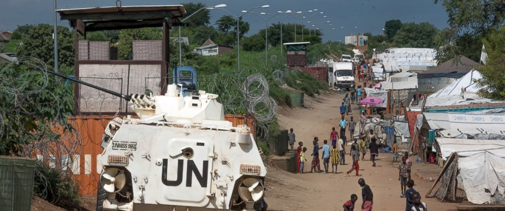 PHOTO: In this photo taken, July 25, 2016, more than 30,000 Nuer civilians sheltering in a United Nations base in South Sudans capital Juba for fear of targeted killings by government forces walk by an armored vehicle manned by Chinese peacekeepers.