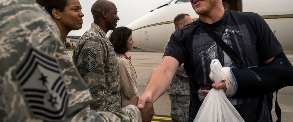 PHOTO: Air Force Airman 1st Class Spencer Stone , right, meets Chief Master Sgt. Phillip Easton, 86th Airlift Wing command chief, Aug. 24, 2015, upon his arrival to Ramstein Air Base, Germany.
