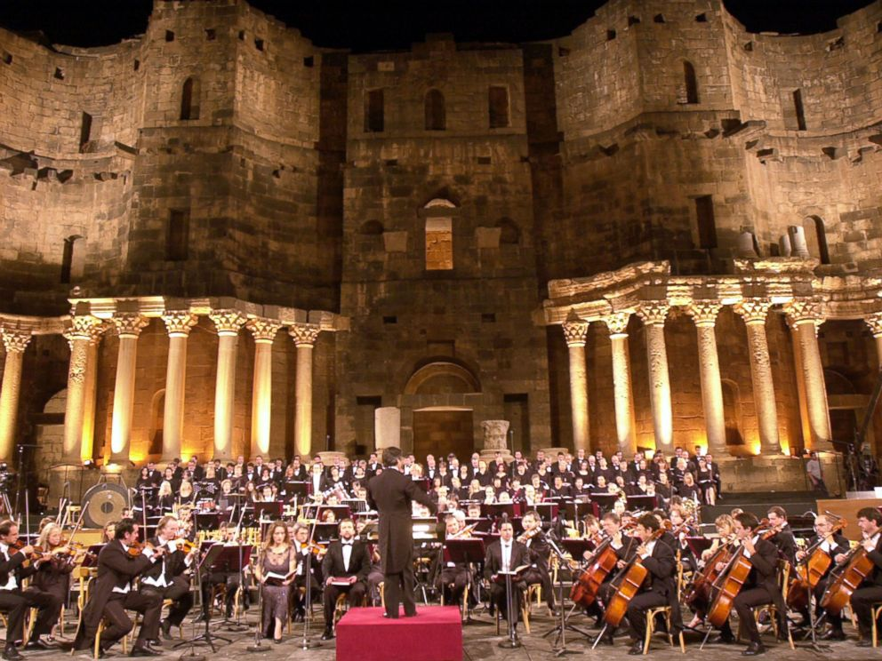 PHOTO:The Italian maestro, Ricardo Muti, leading late Sunday, July 25, 2004, more than 300 singers and musicians at the roman Bosra stadium, which was built 2,000 years ago in Daraa province, south of Damascus and accommodates some 16,000 people.