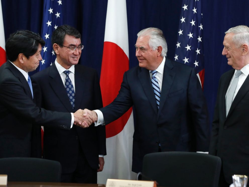 Japanese Defense Minister Itsunori Onodera, left, next to Japanese Foreign Minister Taro Kono, shakes hands with Secretary of State Rex Tillerson, at the start of a Security Consultative Committee meeting, Thursday, Aug. 17, 2017.