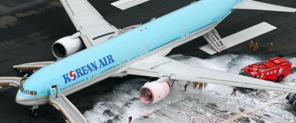 PHOTO: Firefighters gather near an engine of a Korean Air jet following an apparent engine fire on the tarmac at Haneda Airport in Tokyo May 27, 2016. All the passengers and crew were evacuated unharmed, Japanese media reported.