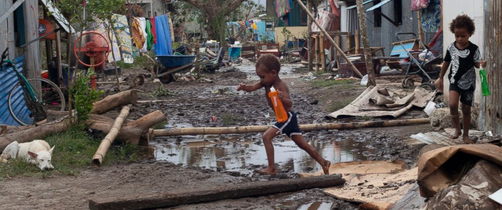 PHOTO: Young children move around debris as residents work to recover from Cyclone Pam in Mele village, on the outskirts of the capital Port Vila, Vanuatu, March 15, 2015.