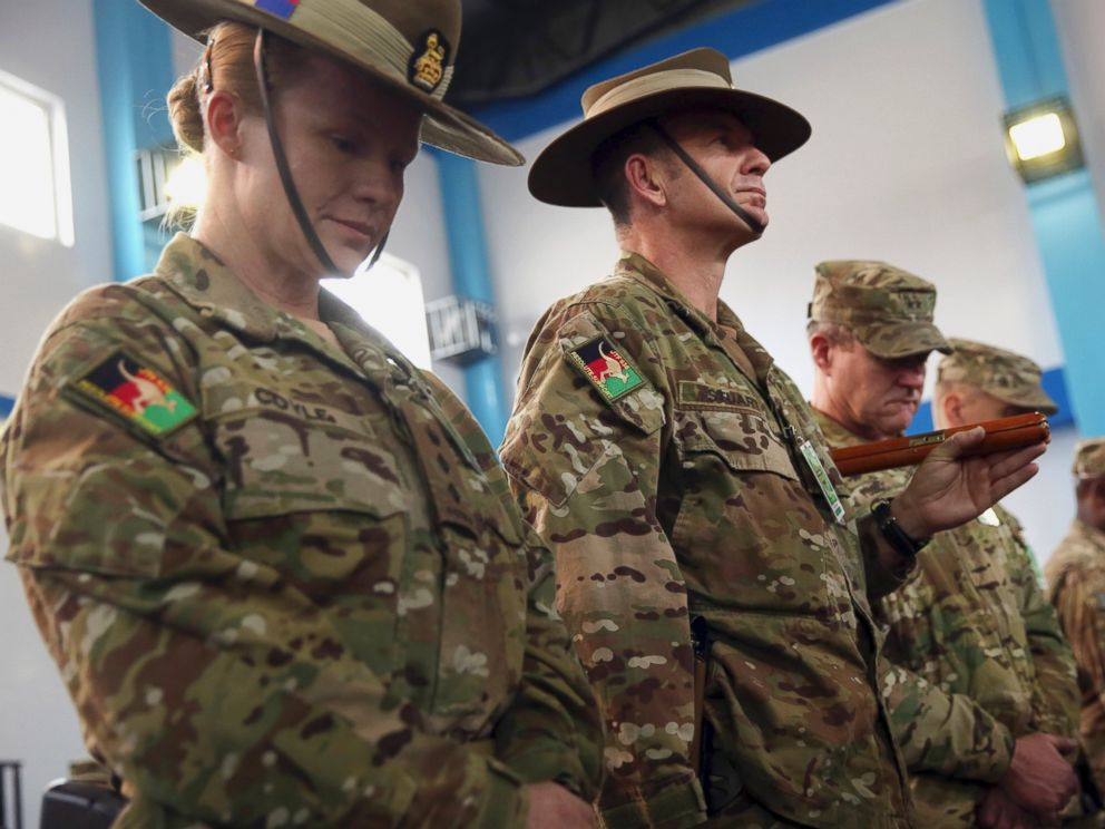 PHOTO: Soldiers for the International Security Assistance Force (ISAF) attend a ceremony at the ISAF headquarters in Kabul, Afghanistan, Sunday, Dec. 28, 2014.