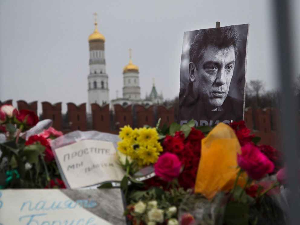 PHOTO: Flowers and a condolence message that reads In memory of Boris are placed with a portrait of Boris Nemtsov, at the site where Nemtsov was gunned down near the Kremlin, in Moscow, Russia, Monday, March 2, 2015.