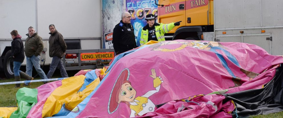 PHOTO: Police and forensic officers attend the scene, March 27, 2016, where a seven-year old girl died after she was blown by the wind about 150 metres on a bouncy castle on Saturday.