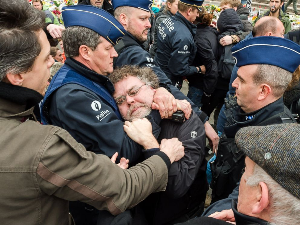PHOTO: Police detain a person at the Place de la Bourse in Brussels, Belgium, April 2, 2016.