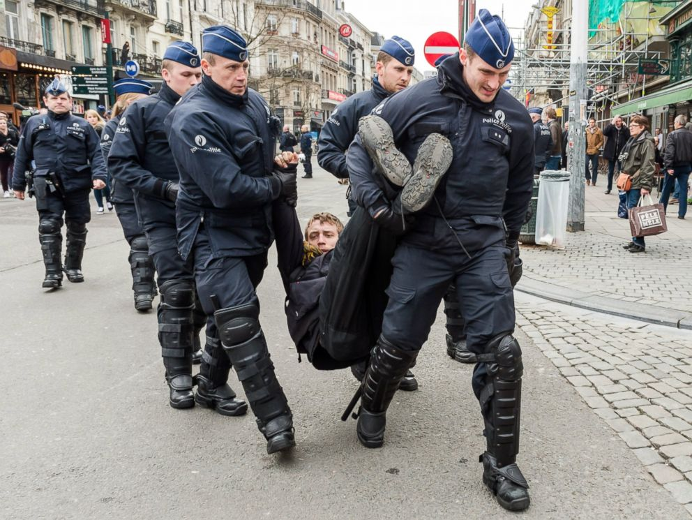 PHOTO: Policemen detain a man at the Place de la Bourse in Brussels, Belgium, April 2, 2016.