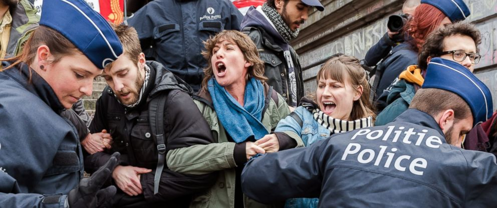 PHOTO: Police detain a group of people at the Place de la Bourse in Brussels, Belgium, April 2, 2016.