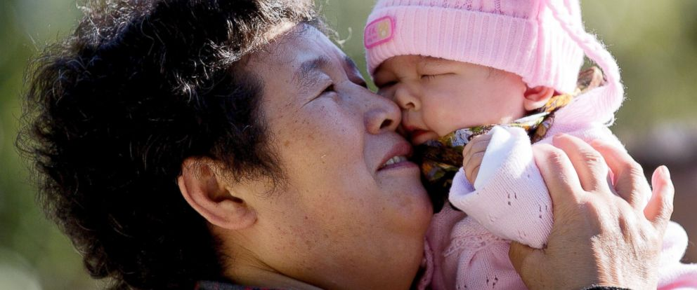 PHOTO: A woman plays with her grandchild at the Ritan Park in Beijing.