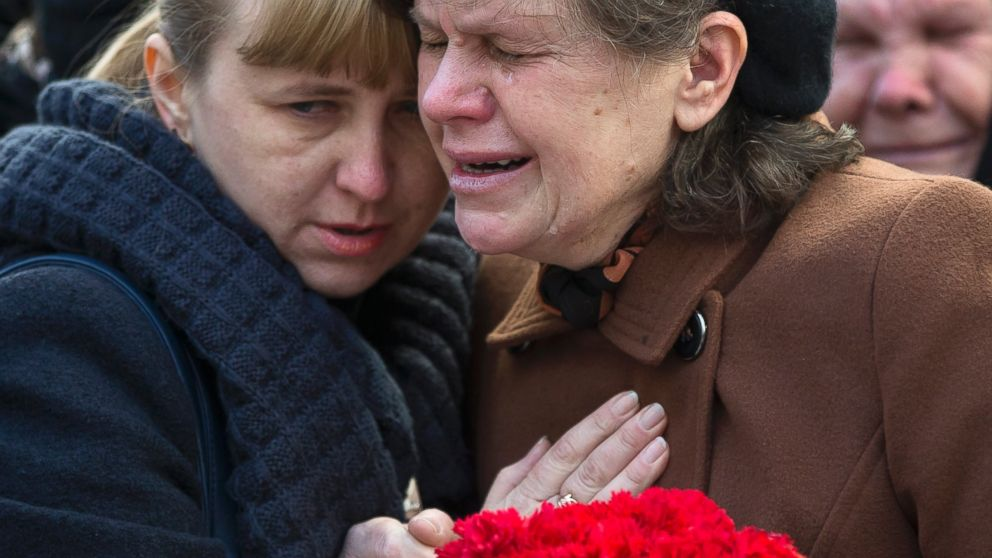 Relatives of Ukrainian soldier Sergey Kokurin, 35, during his funeral in Simferopol, Crimea, Saturday, March 22, 2014.