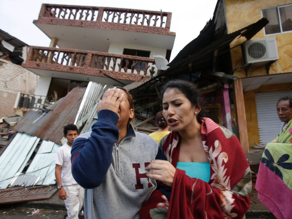 PHOTO: A woman cries as she stands next to house destroyed by the earthquake in the Pacific coastal town of Pedernales, Ecuador, April 17, 2016.