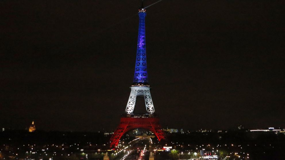 The Eiffel Tower is illuminated in the French national colors red, white and blue in honor of the victims of the terror attacks in Paris, Nov. 16, 2015.