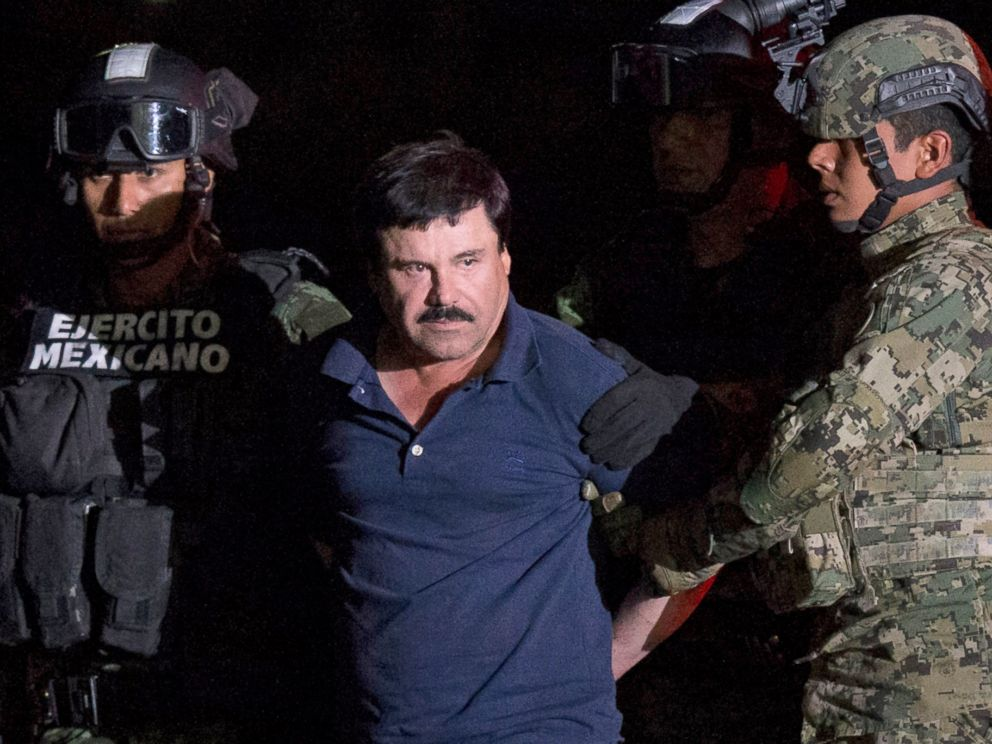 PHOTO:Mexican drug lord Joaquin El Chapo Guzman is escorted by army soldiers to a waiting helicopter, at a federal hangar in Mexico City, Jan. 8, 2016.