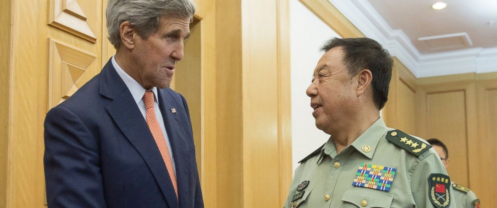 PHOTO: U.S. Secretary of State John Kerry, left, and Chinese Vice Chairman of the Central Military Commission General Fan Changlong, right, shake hands prior to a meeting at the Ministry of National Defense in Beijing, May 16, 2015.