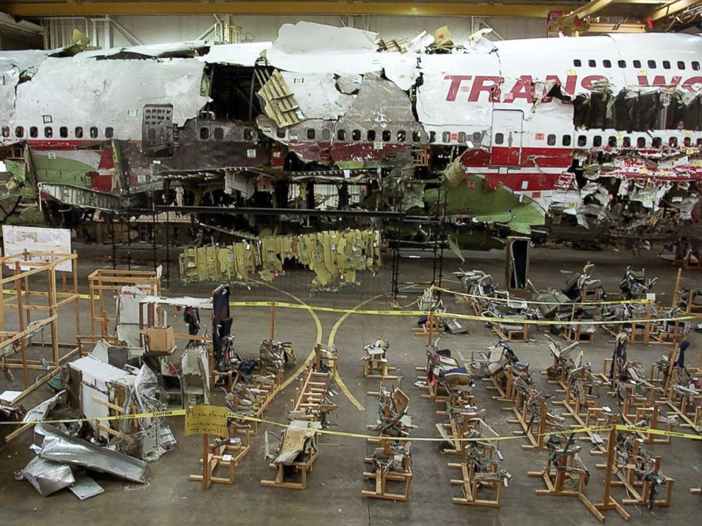 PHOTO: The seats, foreground, and the wreckage of TWA Flight 800 sit in a hangar in Calverton, N.Y. on July 16, 2001.