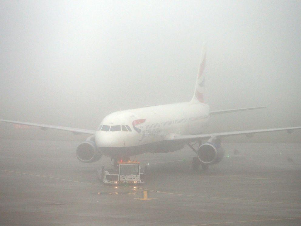 PHOTO: A British Airways plane seen through fog at Terminal 5 Heathrow Airport, London, Nov. 2, 2015.