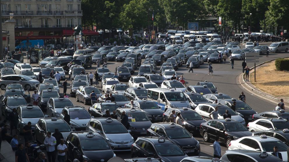Taxis gather at a major entrance of Paris, June 25, 2015, in Paris.