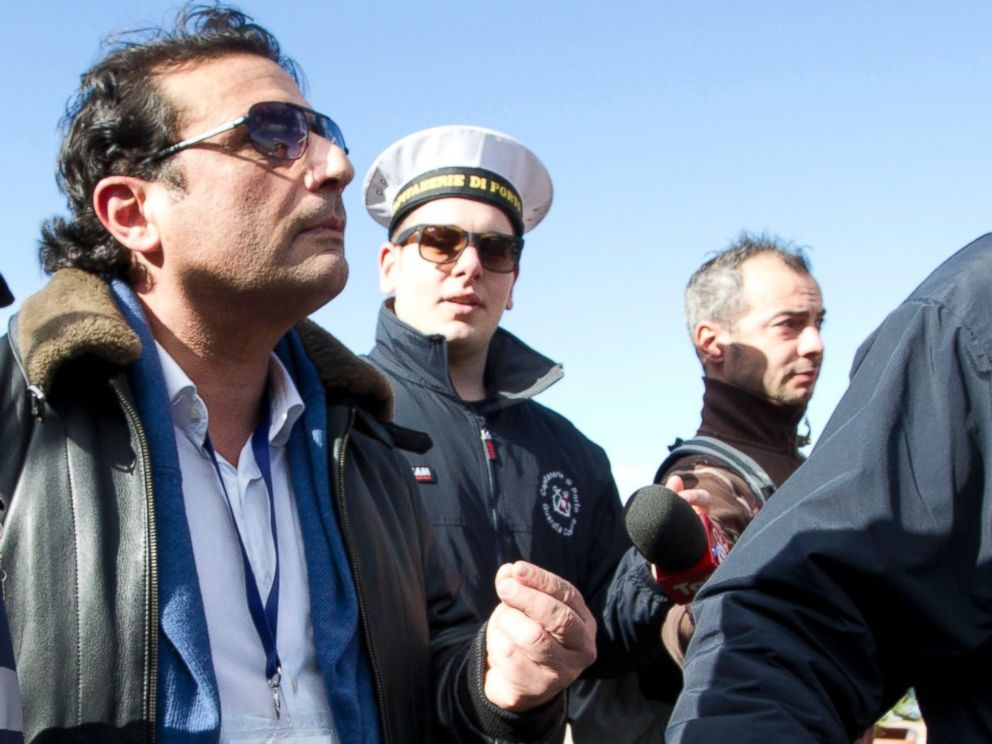 PHOTO: Captain Francesco Schettino walks in Giglio port after boarding the wreck of the Costa Concordia cruise ship, just off the coast of the Giglio island, Feb. 27, 2014.
