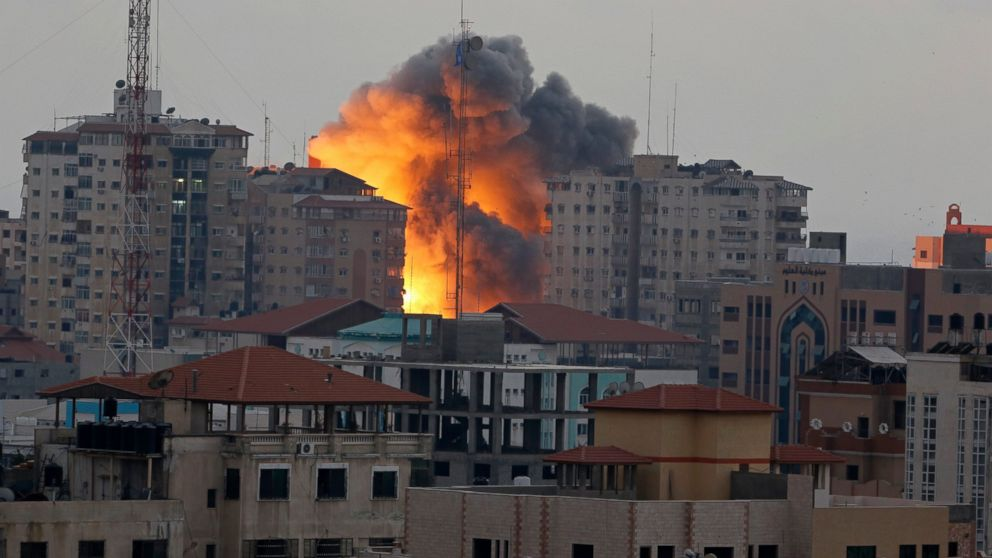 A ball of fire rises from an explosion on al-Zafer apartment tower following an Israeli air strike in Gaza City, in the northern Gaza Strip, Aug. 23, 2014.