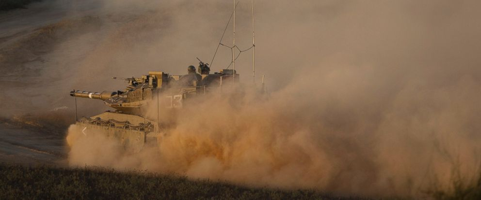 PHOTO: An Israeli tank moves into position on the Israel-Gaza Border, July 8, 2014.