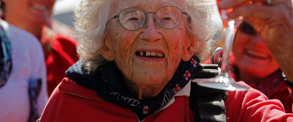 PHOTO: Centenarian Georgina Harwood, celebrates after her tandem parachute jump forming part of her birthday celebrations, in Cape Town, South Africa, Saturday, March 14, 2015.