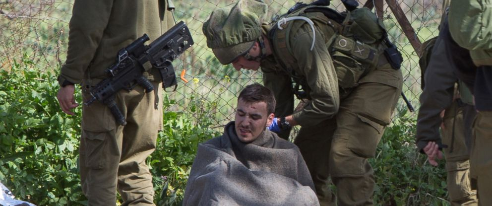 PHOTO: Israeli soldiers treat a wounded soldier near the Israel-Lebanon border on Jan. 28, 2015.