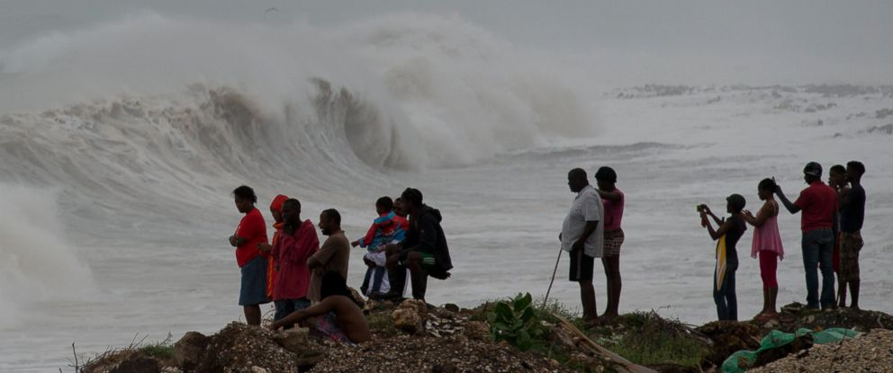 PHOTO: People stand on the coast watching the surf produced by Hurricane Matthew, on the outskirts of Kingston, Jamaica, Oct. 3, 2016.