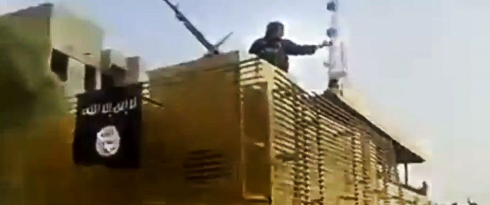 PHOTO: In this June 17, 2014 image taken from video uploaded to a militant social media account, al-Qaida-inspired Islamic State of Iraq and the Levant militants arrive to the country?s largest oil refinery in Beiji.