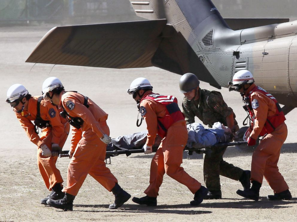 PHOTO: Rescue workers carry a climber rescued from Mount Ontake into an ambulance, in Kiso, Nagano prefecture in central Japan, Sept. 28, 2014.