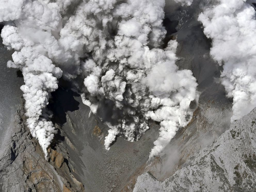 PHOTO: Dense fumes are spewed out from several spots on the slope of Mt. Ontake as the volcano erupts in central Japan, Sept. 27, 2014.