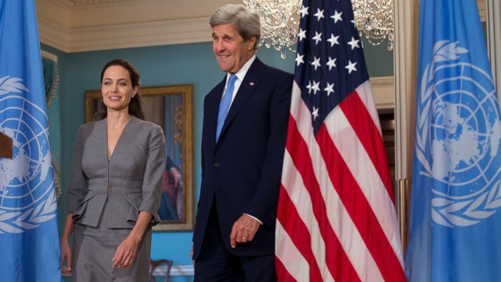 Secretary of State John Kerry, right, with United Nations High Commissioner for Refugees Special Envoy Angelina Jolie walks to the Treaty Room at the Department of State in Washington, June 20, 2016. UNHCR Special Envoy Angelina Jolie Pitt called for action on World Refugee Day.