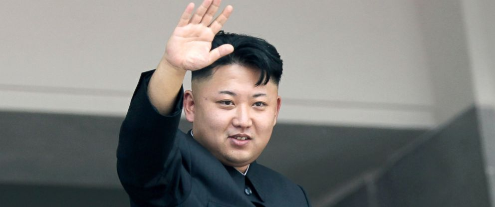 PHOTO: North Koreas leader Kim Jong Un waves to spectators and participants of a mass military parade, July 27, 2013, in Pyongyang, North Korea.