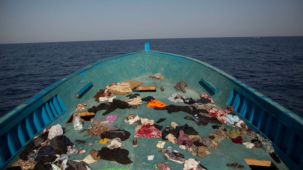 Belongings left behind by migrants are seen in the floor of a wooden boat where more than seven hundred migrants were fleeing Libya, during a rescue operation in the Mediterranean sea, about 13 miles north of Sabratha, Libya, Aug. 29, 2016.