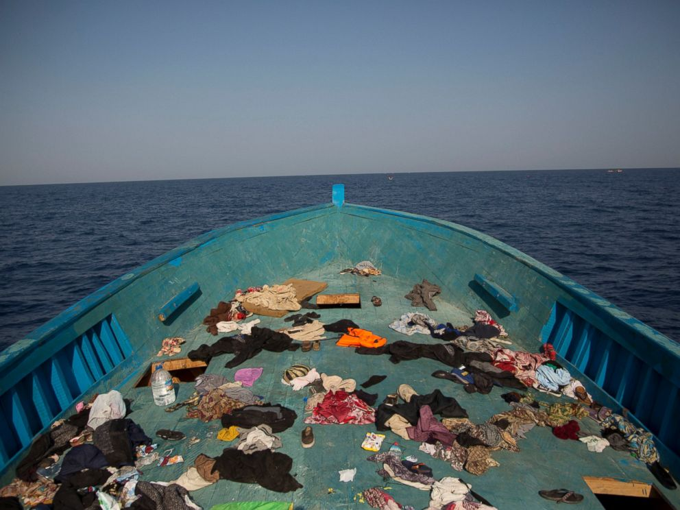PHOTO: Belongings left behind by migrants are seen in the floor of a wooden boat where more than seven hundred migrants were fleeing Libya, during a rescue operation in the Mediterranean sea, about 13 miles north of Sabratha, Libya, Aug. 29, 2016.