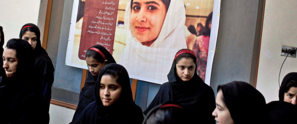 PHOTO: Pakistani girls gather under a poster of Malala Yousufzai in her old school in Mingora, Swat Valley, Pakistan, in this Nov. 15, 2012 file photo.