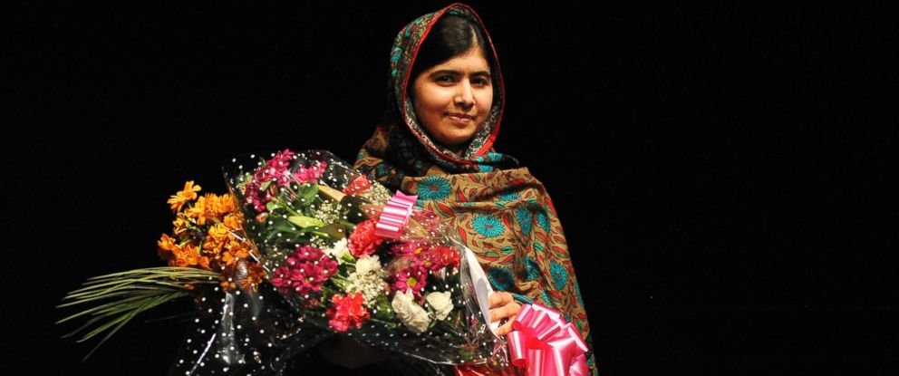 PHOTO: Malala Yousafzai poses with a bouquet after speaking during a media conference at the Library of Birmingham, in Birmingham, England, Oct. 10, 2014, after she was named as winner of The Nobel Peace Prize.